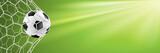 Fototapeta sport - Fußball Hintergrund mit Fußball im Tor Netz