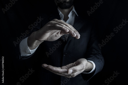 Foto op Plexiglas Fitness Stretched hand of man isolated over dark background.