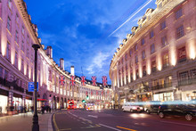 Popular Tourist Regent Street With Flags Union Jack In Night Lights Illumination In London, England, United Kingdom