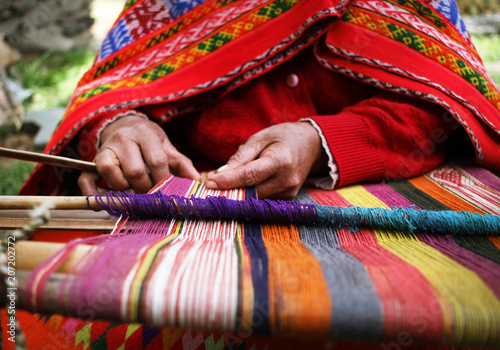 Obraz Close up of a woman weaving in Peru - fototapety do salonu