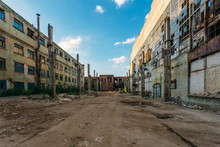 Territory Of Abandoned Industrial Area Waiting For Demolition. Broken And Burnt Buildings. Former Voronezh Excavator Factory