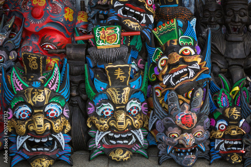 Spoed Foto op Canvas Graffiti collage Chinese Wooden Masks Souvenirs in the market near the site of the Great Wall of China Mutianyu