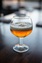 Foamy Amber Beer In A Specialty Glass