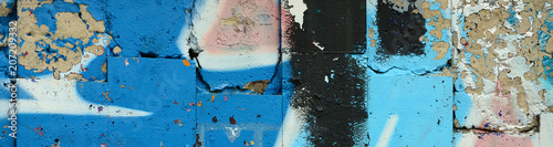 plakat Street art. Abstract background image of a fragment of a colored graffiti painting in blue tones