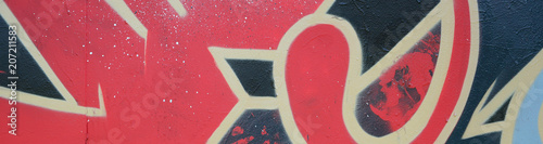 Street art. Abstract background image of a fragment of a colored graffiti painting in red tones