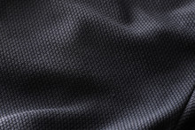 Close-up Polyester Fabric Texture Of Black Athletic Shirt