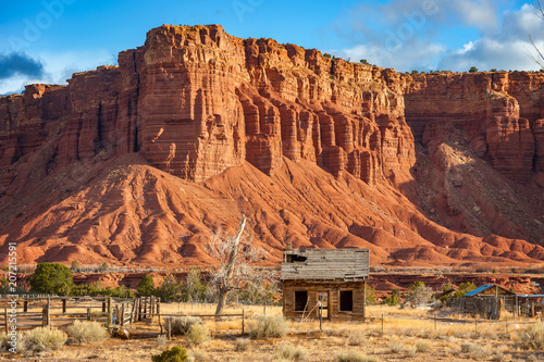 Fotobehang Natuur Park American Southwest Desert Landscape. Classic eroded Navaho sandstone bluffs and blue skies bring up an image of the old west. This is especially true here in Torrey, Utah, near Capitol Reef Park.