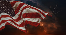 American Flag Waving In The Wind Thunderstorm With Lightning Multiple Forks Of Lightning Pierce The Night Sky