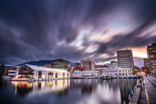 Elizabeth Pier And Hobart Waterfront With Mount Wellington In He Background, Captured At Sunset In Tasmania, Australia