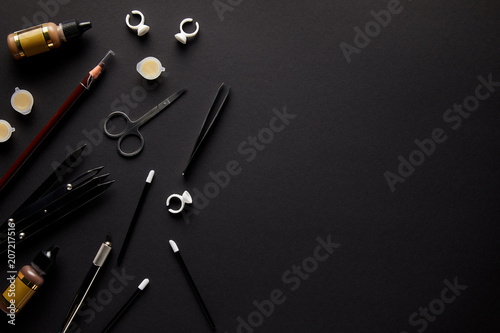elevated view of scissors, pencil and brushes for permanent makeup isolated on black - 207217516