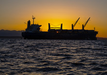 Cargo Ship Sunset Water And Mountains