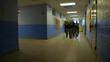 A squad of police walk in a school with guns drawn to train for responding to school shootings.