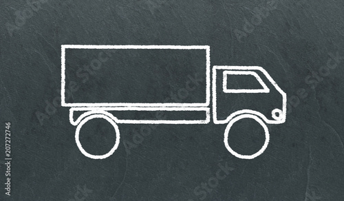 Fényképezés Dessin de camion à la craie sur une ardoise