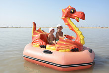 In The Summer At Sea, Children Ride A Catamaran On A Boat In The Form Of A Dragon.