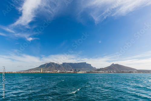 Staande foto Afrika View of Table Mountain in Cape Town from the ocean with blue sky