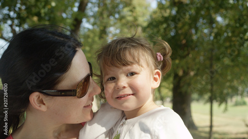 Fotografie, Obraz  CLOSE UP: Loving Caucasian mother looks at her smiling little baby daughter