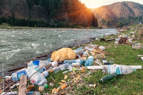 plastic garbage on the river bank Wallpaper Mural