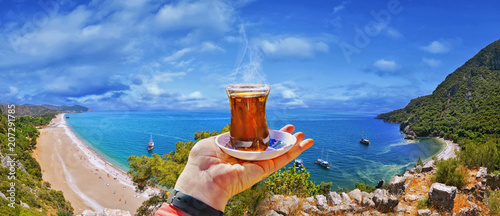 Poster Turquie Morning cup of tea with view of colorful panoramic Olympos beach , Cirali, Antalya Province ,Turkey