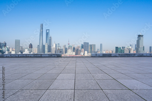 city skyline with empty floor in urban square Poster