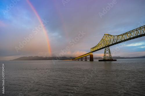 Rainbow over river and bridge in Astoria, Oregon Canvas Print