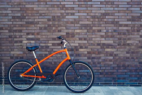 City bike on a brick wall background Canvas