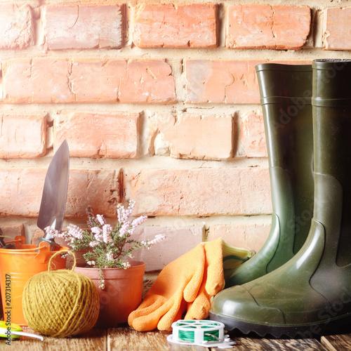 Printed kitchen splashbacks Garden Gardening tools of shovel rake rope gloves on wooden floor