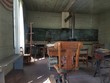 inside an old one room school with desks