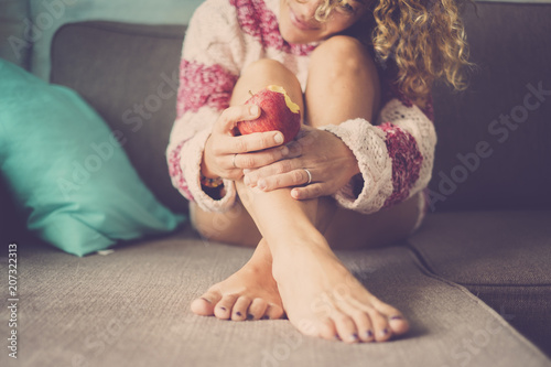 Fotografie, Obraz  tenderness concept with beautiful caucasian curly hair woman smiling and eating an apple fruit to take care of her health and body
