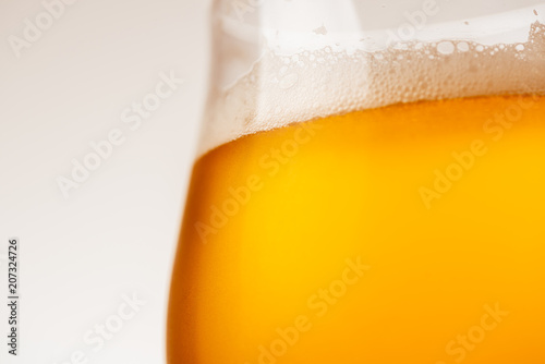 Glass of beer on white background Poster