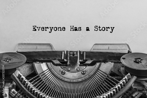 Everyone has a story, typed words on a vintage typewriter. old paper. close-up
