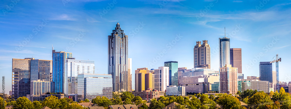 Fototapety, obrazy: Downtown Atlanta Skyline showing several prominent buildings and hotels under a blue sky.