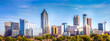 canvas print picture - Downtown Atlanta Skyline showing several prominent buildings and hotels under a blue sky.