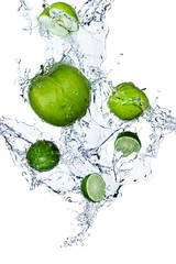 Splash of water and fruit on white background