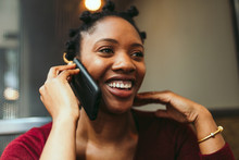 Smiling Businesswoman Talking On Smartphone