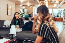 Businesswomen Talking In Moder...