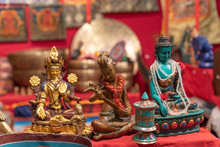 Three Different Statuettes Depicting The Buddha In An Ethnic Market