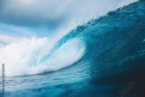 Ocean barrel wave in ocean. Breaking wave for surfing in Bali