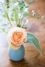 Sweet Bud Vase Arrangement Of One Peach Rose With Lush Greenery