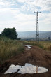 Electrical pylon and pool on the dirt road