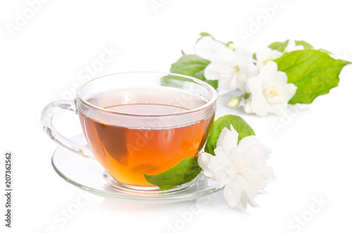 Fotografie, Obraz  Glass cup of Tea with jasmine flowers and leaves isolated on white background