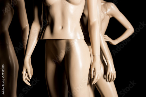 close-up view of naked plastic mannequins on black Wallpaper Mural