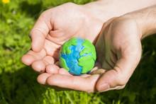 Plasticine Earth In Man`s Hand...