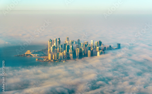 Staande foto Midden Oosten Aerial view of Doha through the morning fog - Qatar, the Persian Gulf