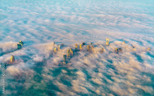 Poster Moyen-Orient Aerial view of Doha through the morning fog - Qatar, the Persian Gulf