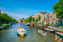 Amsterdam, The Netherlands May 27 2018 - Canal Cruise And Small Pleasure Boat Sailing On The Oudeschans Canal