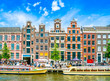Amsterdam, The Netherlands May 27 2018 - The Rokin Canal with tourist and locals visiting a annual market