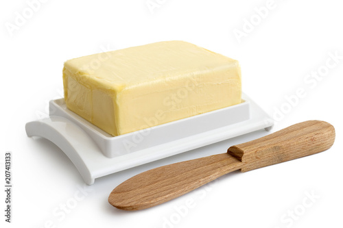 Fotografia, Obraz  A whole block of butter on white plastic butter dish isolated on white
