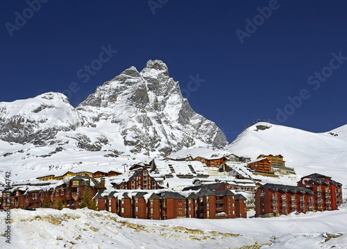 Panoramic view on Matterhorn peak - Monte Cervino, Italy. Mountain situated on the border between Switzerland and Italy, over the Swiss Zermatt and the Italian town of Breuil-Cervinia
