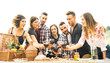 canvas print picture - Young friends having fun outdoors drinking red wine at barbecue - Happy people eating healthy food at harvest time in farmhouse vineyard winery - Youth friendship concept on warm vintage filter