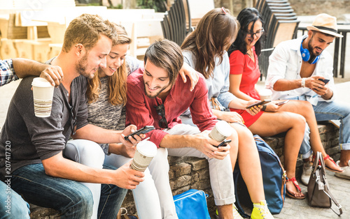 Canvastavla  Multiracial millennials group using smart phone at city college backyard - Young